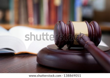 gavel and books on the table - stock photo