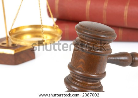 gavel and books on white background, shallow dof