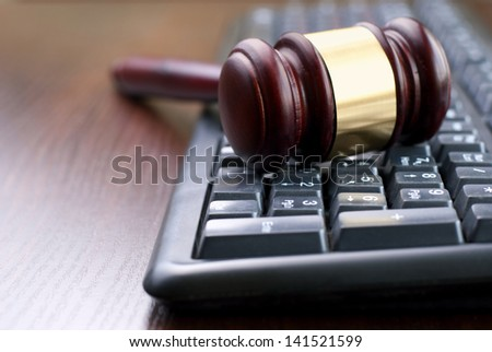 gavel and computer keyboard, conceptual image - stock photo