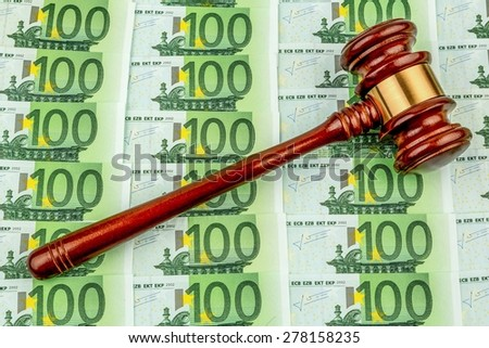 gavel and euro banknotes. symbol photo for costs in court, rule of law and auctions - stock photo