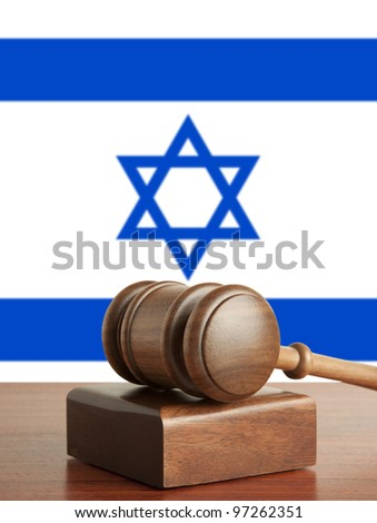 Gavel  and Flag of Israel - stock photo