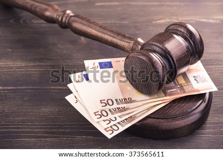 Gavel and four euro banknotes.Auction bidding, judicial system corruption concept.Toned - stock photo