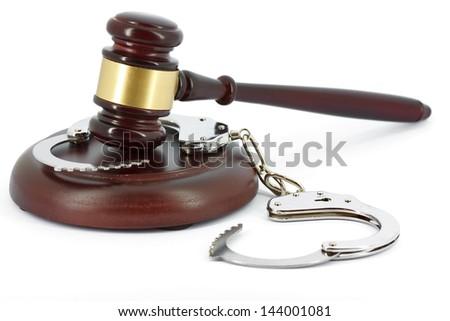 Gavel and handcuffs - stock photo