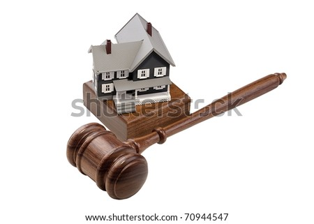 Gavel and house model isolated on a white background. - stock photo