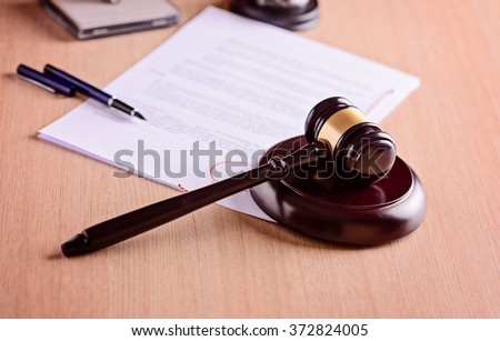 Gavel and judgement on desk. Law concept - stock photo