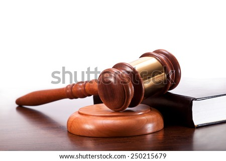 Gavel and law book on the table - stock photo