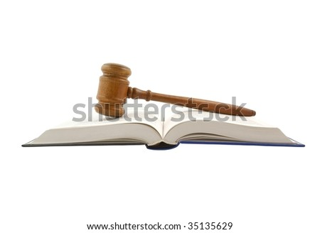 Gavel and legal book isolated on white - stock photo