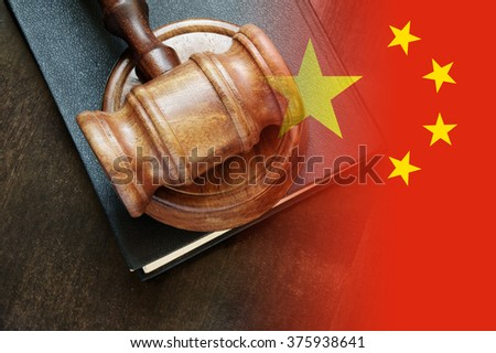 Gavel and legal book on wooden table, collage with flag of china - stock photo