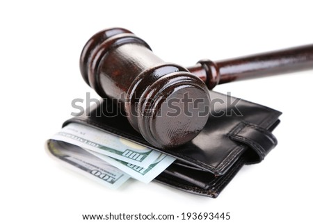 Gavel and money in wallet isolated on white - stock photo