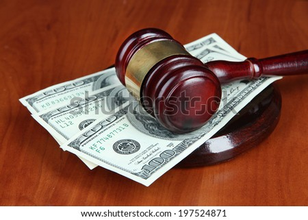 Gavel and money on table close-up - stock photo