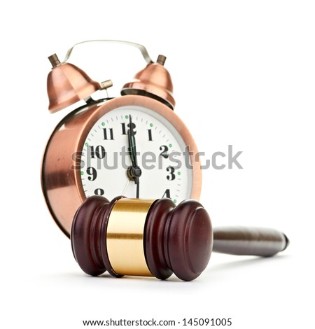 Gavel and old clock - stock photo