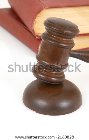 gavel and old rusty books on white background