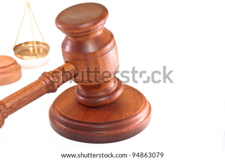 gavel and scales of justice on a white background - stock photo