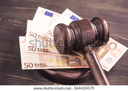Gavel and some euro banknotes.Auction bidding, judicial system corruption concept.Toned - stock photo