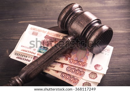 Gavel and some ruble banknotes.Auction bidding, judicial system corruption concept.Toned - stock photo