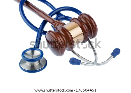 gavel and stethoscope, symbol photo for bungling doctors and error - stock photo