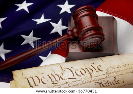 Gavel, and U.S. Constitution shot on American flag - stock photo