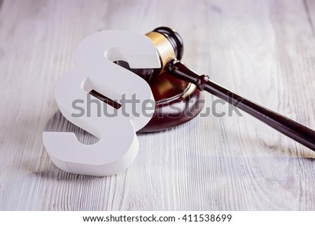 Gavel and wooden paragraph - law symbols in court library. Law concept - stock photo