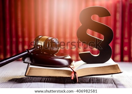 Gavel and wooden paragraph the symbols of law in court library with legal codes. Law concept - stock photo
