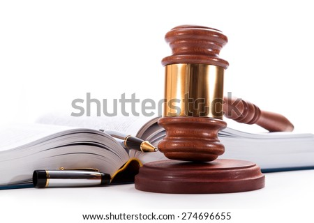 Gavel, book and pen on a white background - stock photo