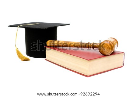 gavel, book with red cover and the cap of the graduate on a white background closeup - stock photo