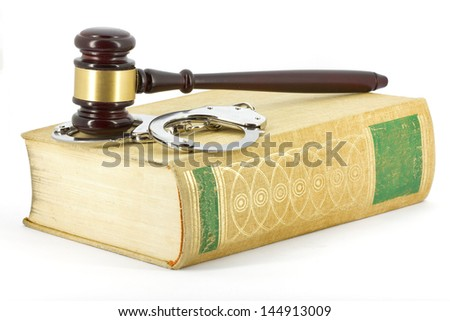 Gavel, handcuffs and book - stock photo