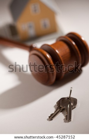 Gavel, House Keys and Model Home on Gradated Background with Selective Focus. - stock photo