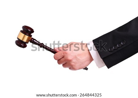 Gavel in hand isolated - stock photo