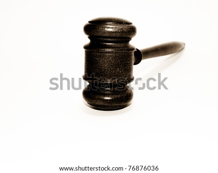 Gavel in sepia on white - stock photo
