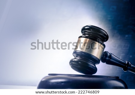 Gavel in wood block - stock photo