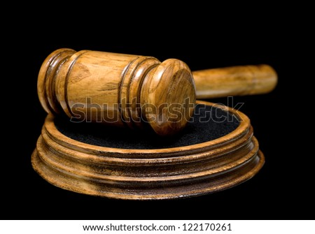 gavel isolated on a black background closeup - stock photo