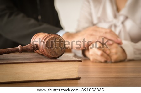 Gavel ,law books with attorneys provide legal advice and consoling to his clients in background. Divorce law ,Legal advice, Family law concept. - stock photo
