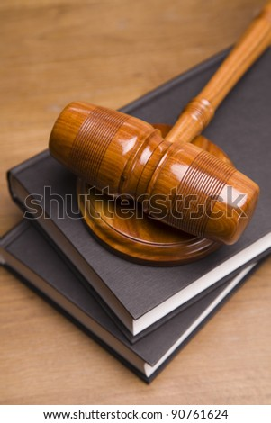 Gavel of justice and gavel on desk with dark background - stock photo