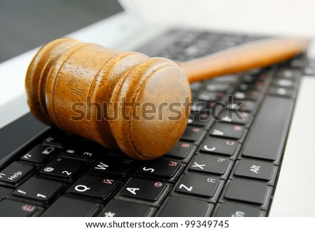 Gavel on a laptop computer close up - stock photo