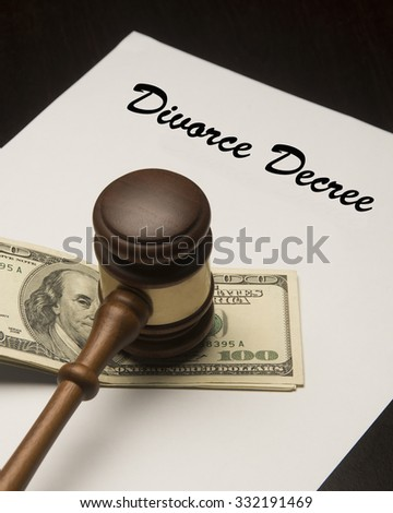 Gavel on a legal document/Divorce Decree/Wooden judicial hammer on money