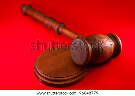 gavel  on a red background - stock photo