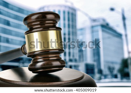 Gavel on building background. Auction concept - stock photo