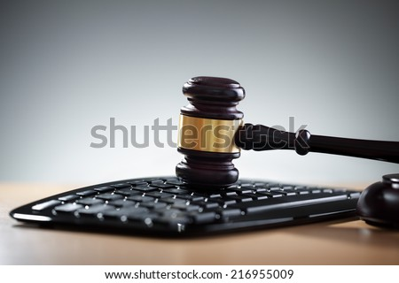 Gavel on computer keyboard concept for online internet auction or legal assistance - stock photo