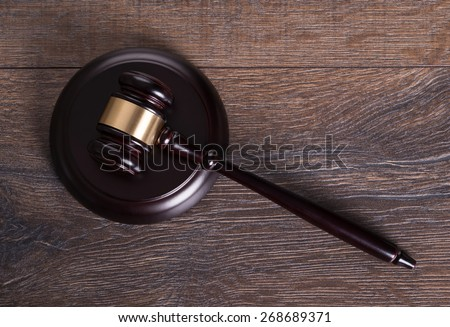 Gavel on judge table in legal concept - stock photo