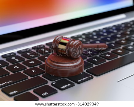 Gavel on laptop with soft focus. Online internet auction - stock photo