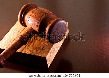 Gavel on the desktop - stock photo