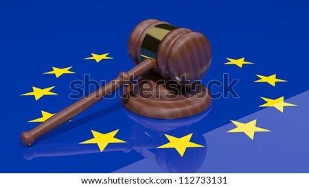 Gavel on the flag of Europe - stock photo