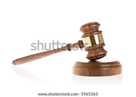 Gavel on white background with reflection - stock photo