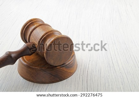 Gavel on white table with copy space - stock photo