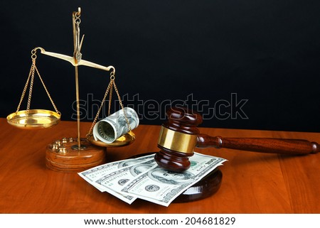 Gavel,scales and money on table on black background - stock photo