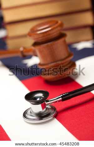 Gavel, Stethoscope and Books on the American Flag with Selective Focus. - stock photo