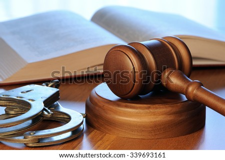 Gavel with book and handcuffs