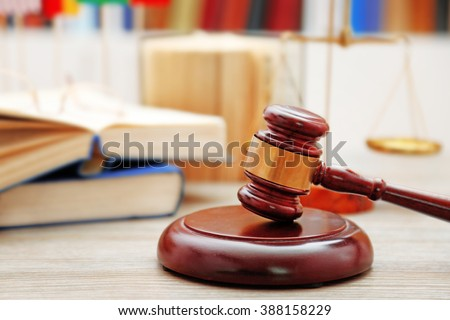 Gavel with justice scales and books on wooden table ,close up - stock photo