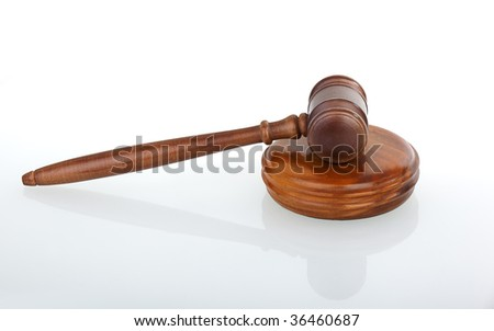 gavel with small reflection in front white background
