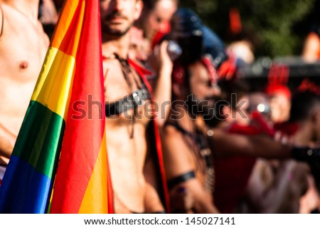 Gay and lesbians walk in the Gay Pride Parade - stock photo